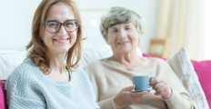 two elderly woman having a cup of coffee